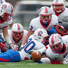 Jason Kapusta/Herald<br /> Richland's Nico Pecora #2 (far right) fights to grab a DeShawn Coleman fumble.
