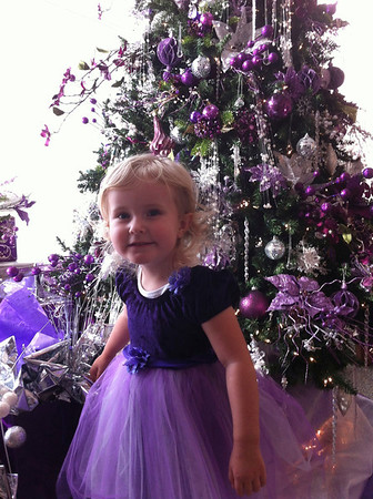 """This is Savannah Snow, daughter of Troy and Nikki Snow of Anderson. This was taken Dec 1, 2012 at Paramount Theater's Festival of Trees.  Savannah wanted to wear her """"Princess Dress"""" and coincidentally this tree in the lobby was a perfect match!<br /> <br /> Photographer's Name: Troy Snow<br /> Photographer's City and State: Anderson, Ind."""