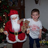 My great-grandson Christian Partlow. He liked my Santa, I guess, because he was just his size. He would not have anything to do with real Santas.<br /> <br /> Photographer's Name: Kathy Partlow<br /> Photographer's City and State: Frankton, Ind.