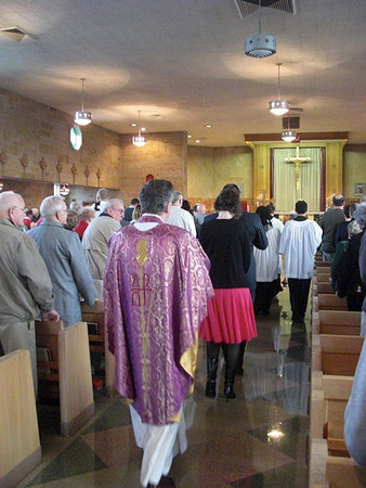 During the 50th Anniversary Celebration of Anderson's St. Ambrose Church on Sunday, the Pastor, Father Bob Williams, wore the same Mass vestment that Bishop John Carberry wore during the Consecration of the Church in 1962. <br /> <br /> Photographer's Name: Art Tate<br /> Photographer's City and State: Anderson, Ind.