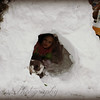 Big snowdrift made into a igloo by 4-year-old Nevaeh Baker.<br /> <br /> Photographer's Name: Precious Baker<br /> Photographer's City and State: Anderson, Ind.