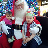 Daniel Vaughn & Ava Minnich visiting the santa at the Mounds mall<br /> <br /> Photographer's Name: Amanda Minnich<br /> Photographer's City and State: Anderson, IN