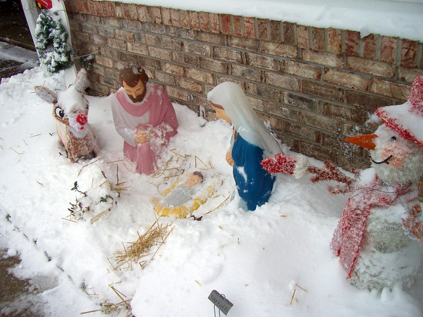 In Art Tate's yard at Crownpointe, Frosty the Snowman looks happy, but Rudolph and the Holy Family figures looked cold during Wednesday's Blizzard. <br /> <br /> Photographer's Name: Art Tate<br /> Photographer's City and State: Anderson, Ind.