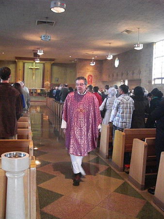 During the 50th Anniversary celebration of Anderson's St. Ambrose Church on Sunday, Father Bob Williams wore the same Mass vestment that Bishop John Carberry wore during the Consecration of the Church in 1962.<br /> <br /> Photographer's Name: Art Tate<br /> Photographer's City and State: Anderson, Ind.
