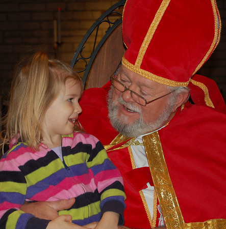 Lauren Beahm tells St.Nicholas what she'd like for Christmas. She was one of dozens of children who visited Trinity Episcopal Church during WinterFest.<br /> <br /> Photographer's Name: Randy Titus<br /> Photographer's City and State: Anderson, IN