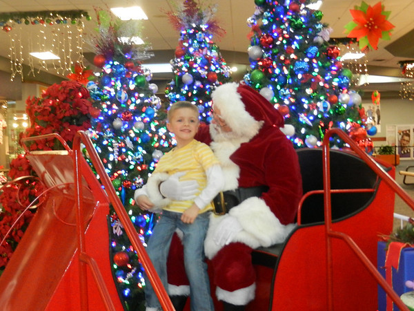 Kylan Adams of Pendleton telling Santa what a good boy he has been and what he would like for Christmas at the Anderson Mounds Mall.<br /> <br /> Photographer's Name: Diana Adams<br /> Photographer's City and State: Frankton, IN