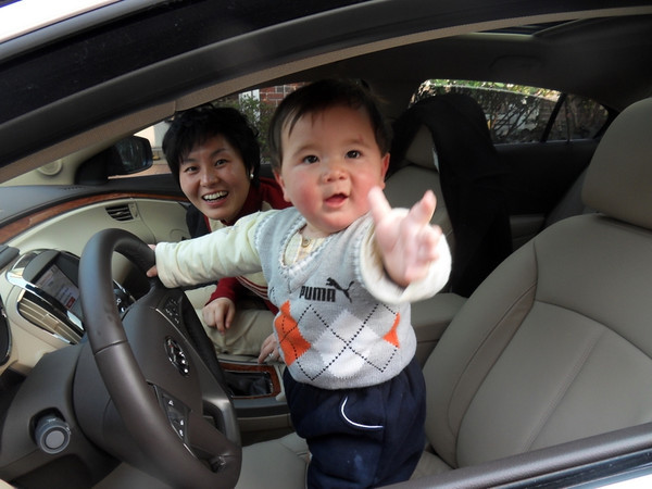 """My newest grandson Eric saying, """"Quick, give me the keys Dad. Mom's ready to go.""""<br /> <br /> Photographer's Name: Harry Kirchenbauer<br /> Photographer's City and State: Anderson, Ind."""