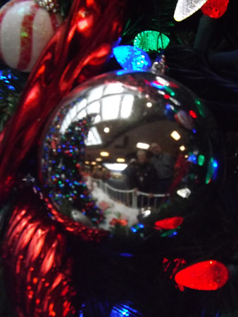 """Reflections"" Taken at Mound Mall, Mr and Mrs Boyd, looking at The Christmas decorations<br /> <br /> Photographer's Name: J.R. Rosencrans<br /> Photographer's City and State: Alexandria, IN"