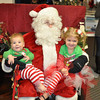 Clayton and Leah Adams of Huntertown visiting Santa.<br /> <br /> Photographer's Name: Diana Adams<br /> Photographer's City and State: Frankton, Ind.