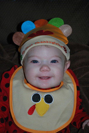 My granddaughter Piper enjoying her first Thanksgiving.<br /> <br /> Photographer's Name: Jenee Wilber<br /> Photographer's City and State: Anderson, Ind.