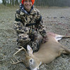 Cole Buck, age 12, of Pendleton, with his first deer: an eight-point buck taken from Madison County. Cole is the son of Derrick and Stephanie Buck of Pendleton.<br /> <br /> Photographer's Name: Stephanie Buck<br /> Photographer's City and State: Pendleton, Ind.