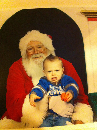 Braxton Smith, age 1 1/2, son of Joel Smith, was not too excited to see Santa!<br /> <br /> Photographer's Name: Jeannette Brown<br /> Photographer's City and State: Anderson, Ind.