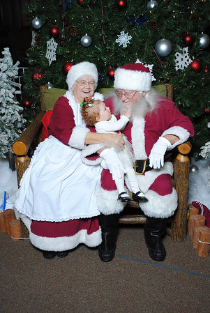 One-year-old Layla Jarvis tugs on Santa's beard.<br /> <br /> Photographer's Name: Jill Morphew<br /> Photographer's City and State: Alexandria, Ind.
