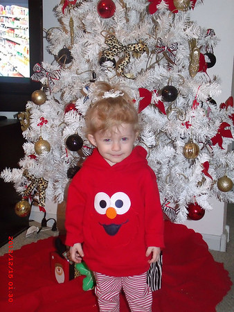 My granddaughter Ella Stoops likes her Christmas tree and is ready for Santa.<br /> <br /> Photographer's Name: Kathy  Stoops<br /> Photographer's City and State: Anderson, Ind.