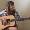 Anderson's own singer/songwriter Nicole Winkler writing a song on her new guitar.<br /> <br /> Photographer's Name: Beth Walker<br /> Photographer's City and State: Anderson, Ind.