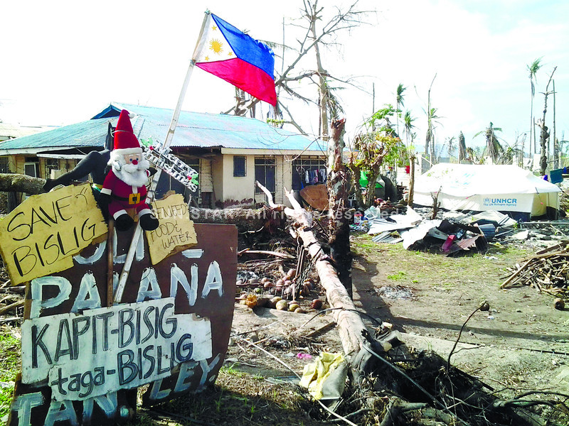 Hope amid the ruins in Tanauan, Leyte a month after Typhoon Yolanda