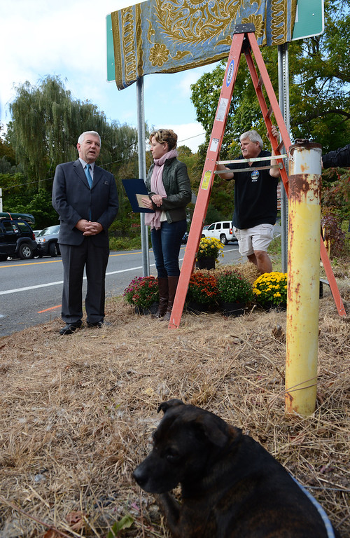 . Even Muddy, Levon Helm\'s dog was at the unveiling  Friday. In the rear Assemblyman Kevin Cahill says a few words standing next to Amy Helm, Levon\'s daughter before the unveiling.