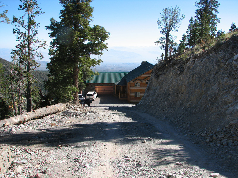 The driveway from the top of the knoll where the gate is now.  His white Escalade is at the garage.