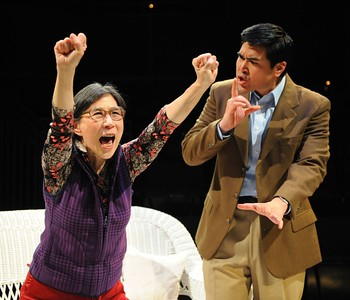 "Wai-Ching Ho, left, and Pun Bandhu in the world premiere of the Denver Center Theatre Company's ""The Catch."" Photo by Terry Shapiro."