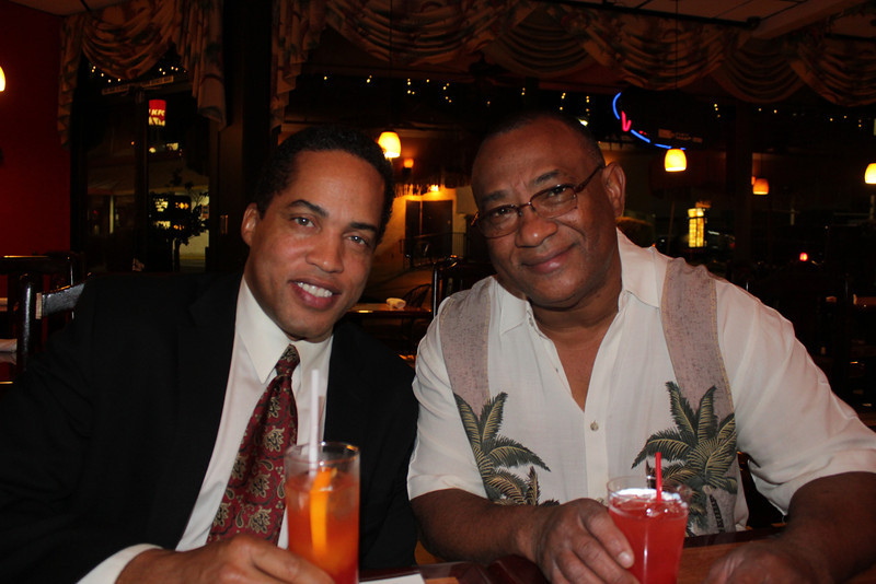America's Court Judge Kevin Ross and Derrick's Jamaican Cuisine toast Derrick's success with Hibiscus Punch.