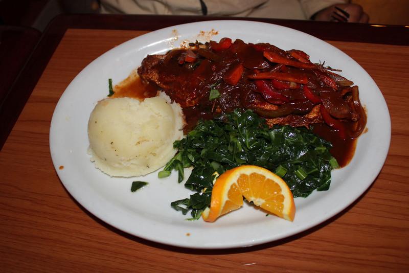 Healing greens, mashed potatoes and Jamaican stew fish (Tilapia).