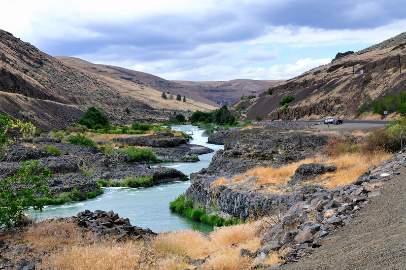 Sherar's Falls on the Deschutes River confines the whole tumult of river to a narrow basalt chute.