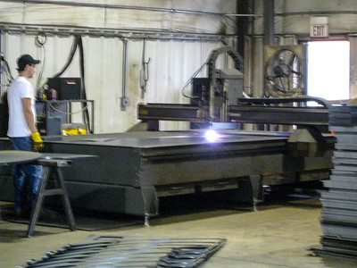 Sheet metal cutting table.