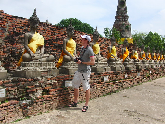 Nomadic Samuel visiting Ancient ruins in Ayutthaya, Thailand.