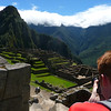 Nomadic Samuel taking photos of Machu Picchu, Peru.