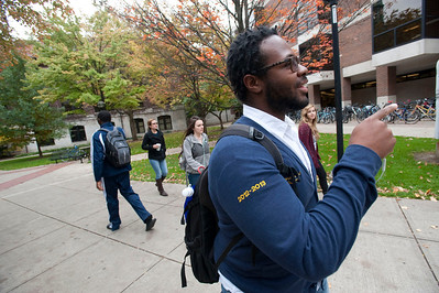 Darren Gordon of Detroit, a University of Michigan senior  majoring in movement science, walks past West Hall in Ann Arbor on Oct 16, 2013.
