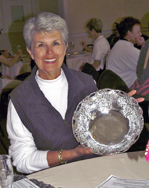Me! I also play a bit of golf - this lovely pewter bowl was awarded when I won my flight - not Championship, but the next one down!