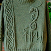 Dicksie just finished knitting the Dragon Sweater pattern by Elsebeth Lavold of Sweden.  Dragon was appliqued on front of sweater.  The five runes below the dragon are from a 1000 year old Swedish alphabet  spelling out D I K S I.  Virtual Yarn, 3 ply, color Dulse.