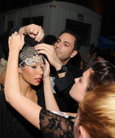 Kevin Gatto, Verde Salon was pinning a headpiece to a model right before she was to hit the catwalk.