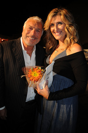 Sal and Inga D'Angelo have a certain glow about them as they leave with parting gifts of popcorn and Gerber daisies.