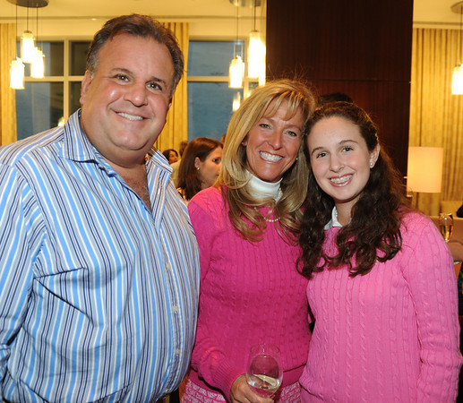 Dr Scott Chanin with pretty in pink wife Susan and daughter Rebecca.