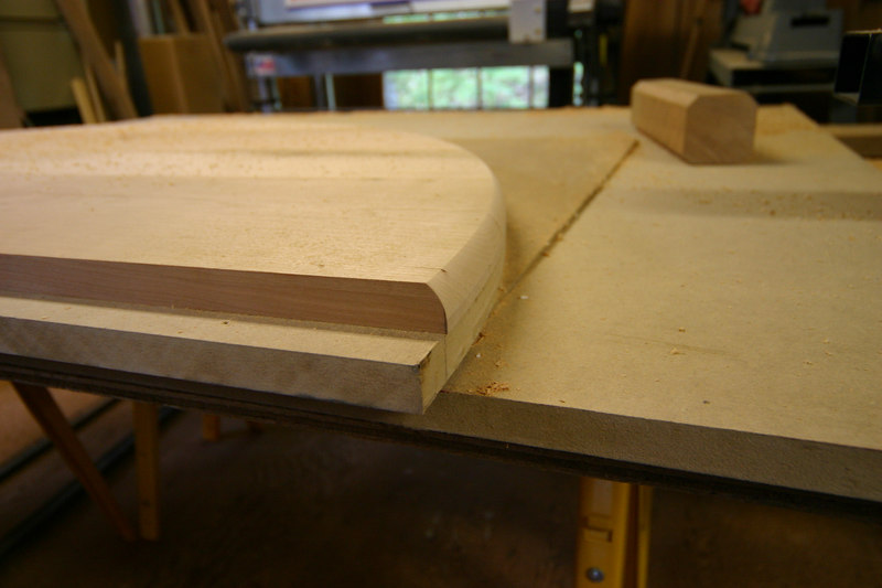 Forming the lower edge of table top
