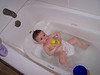 A great baby tub. It has sort of a fat pillar in the middle to keep his bottom from sliding down further.