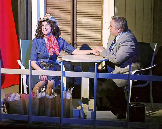 "Mark Maynard | for The Herald Bulletin<br /> Con-man Lawrence Jameson (Eddie Franklin) romances his latest target, Jolene Oaks (Jamie Oaks) in ""Dirty Rotten Scoundrels."""