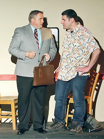 "Mark Maynard | for The Herald Bulletin<br /> Expert con-artist Lawrence Jameson (Eddie Franklin) makes the acquaintance of swindler Freddy Benson (Andy Ober) on a train in Anderson's Mainstage Theatre's production of ""Dirty Rotten Scoundrels."""