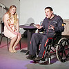 Mark Maynard | for The Herald Bulletin<br /> Christine (Jenny Sells) listens with rapt attention as Freddy (Andy Ober) explains how his legs were paralyzed in a war injury.