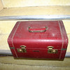 Small red travel case.