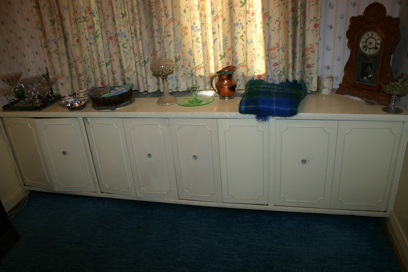 This Gallery contains the items that are in or on the built-in cabinets that cover the dining room hot water radiators.