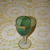 Green gold rimmed wine glass.  It is not in the best of condition as some of the gold is worn.