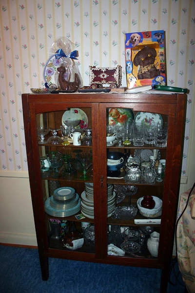 The glass fronted china cabinet is a bequest from Grandma to Dale.  Would Dale please confirm through Jessica that she (or Jenny or Jessica) wants it.  If not, Gregory will probably keep it.