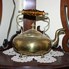 Grandma indicated that this brass teapot should go to Gregory and then to Jessica or Jenny.  However, Gregory wonders if Jessica or Jenny would like it now.  If so, please let Gregory know through Jessica.
