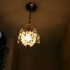 "Lower hall crystal chandelier.<br /> <br /> This is end of the ""Lower Hallway"" Gallery.<br /> <br /> The next Gallery is ""Living Room Contents."""