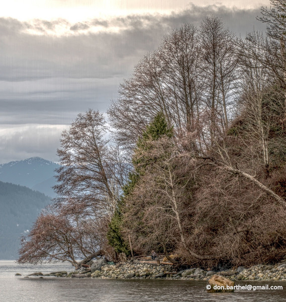 HDR'd image of man sitting at beach north of Wreck Beach Vancouver BC.