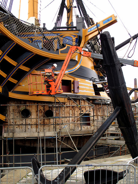 The side of Victory under repair.   Many of the timbers are being replaced due to some spreading of the hull.