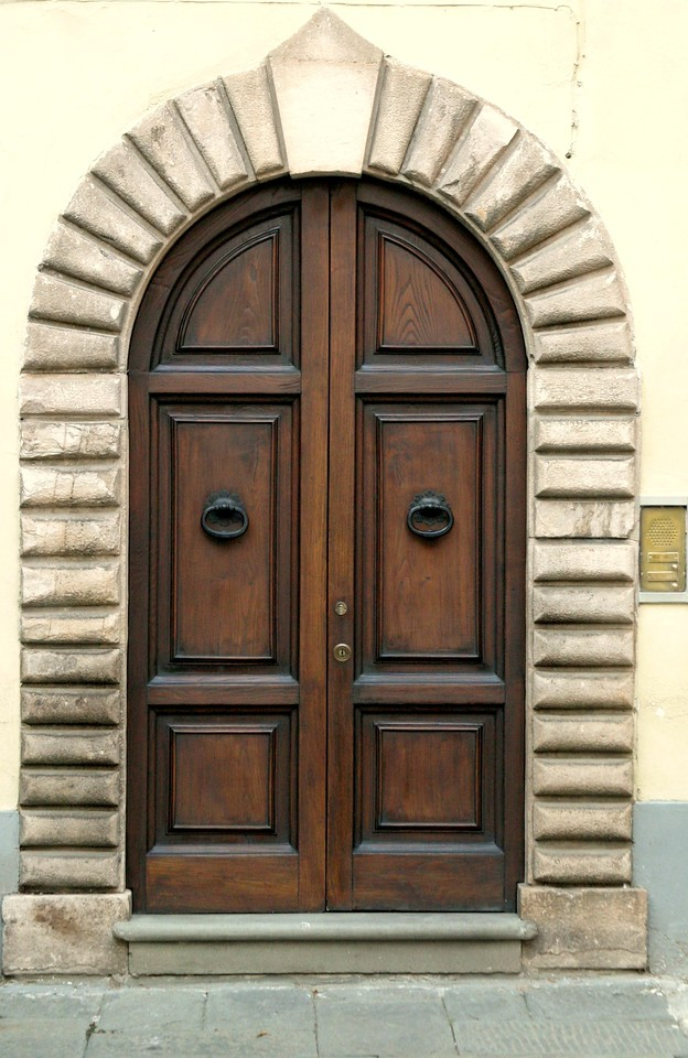 Wood Door with Stone Arch
