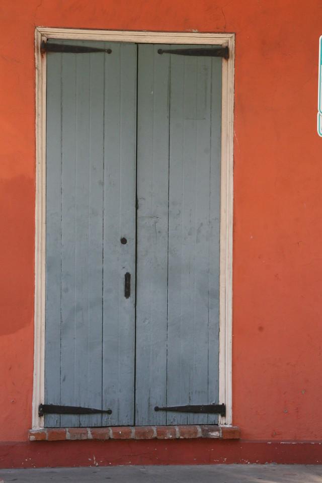 Grey door,peach wall French Quarter, New Orleans, La.